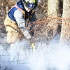 PETE  BANNAN-DIGITAL FIRST MEDIA    <br /> A Westwood firefighter extinguishes a brush fire on Park Ave.in E. Fallowfield Township. Westwood Battalion chief John Sly said the fire covered approximately 2 1/2 acres.   It took crews from Westwood, Cochranville, Wagontown and Po-Mar-Lin ftwo hours to bring the fire under control and extinguish hotspots.