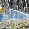 PETE  BANNAN-DIGITAL FIRST MEDIA    <br /> A firefighter extinguishes a brush fire on Park Ave.in E. Fallowfield Township. Westwood Battalion chief John Sly said the fire covered approximately 2 1/2 acres.   It took crews from Westwood, Cochranville, Wagontown and Po-Mar-Lin ftwo hours to bring the fire under control and extinguish hotspots.