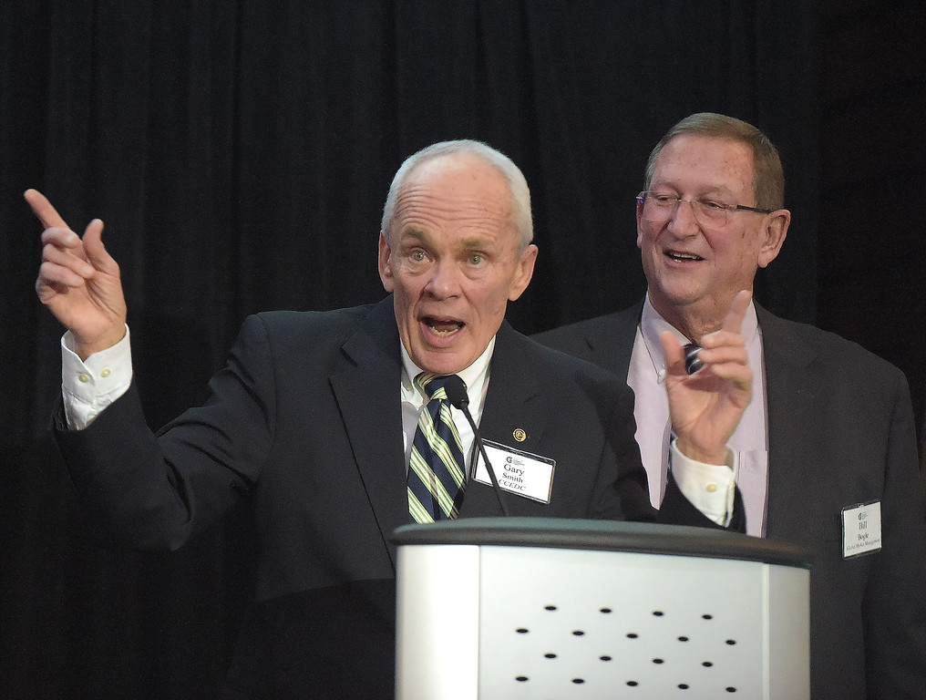 . PETE  BANNAN-DIGITAL FIRST MEDIA       Chester County Economic Development Council president, Gary Smith and Chair of the CCEDC Board of Directors, Bill Bogle speak at the at Business Achievement Award Dinner on March 30 at the Phoenixville Foundry.
