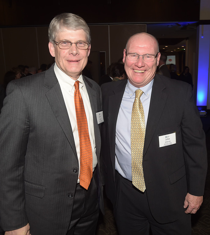 . PETE  BANNAN-DIGITAL FIRST MEDIA     Dr.  Jerry Parker, president of Delaware County Community College,left,  with  Delaware County Community College treasurer, John Glavin after Parker was inducted into the Chester County Business Hall of Fame at the council�s Business Achievement Award Dinner on March 30 at the Phoenixville Foundry.