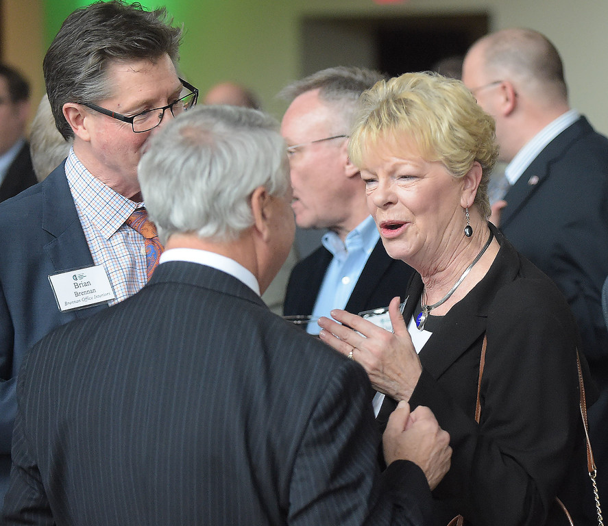 . PETE  BANNAN-DIGITAL FIRST MEDIA       Nancy Corson, former member the Chester County Economic Development Council speaks with George Zumbano of Gawthrop Greewood and Brian Brennan at the business achievement award dinner at the Phoenixville Foundry.
