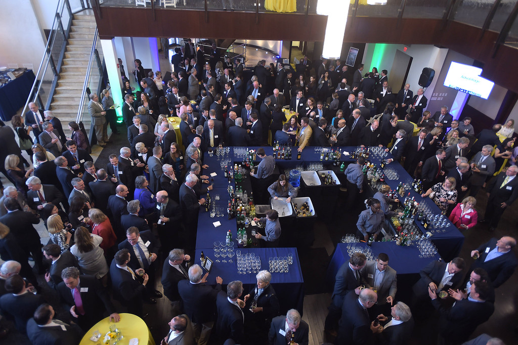 . PETE  BANNAN-DIGITAL FIRST MEDIA       Guests to the Chester County Economic Development Council;s Business Achievement Award Dinner socialize at the Phoenixville Foundry.