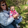 PETE BANNAN- DIGITAL FIRST MEDIA    SHaron McCoy with her granddaughter Emma Brownn, 1, fish at the first annual Coatesville fishing rodeo on the banks of the West Brandywine Creek at the Riverwalk Trail.