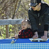 PETE BANNAN- DIGITAL FIRST MEDIA Chen Shu Ren and Hassan, 3, of Coatesville take part in the first annual COatesville fishing rodeo on the banks of the West Brandywine Creek at the Riverwalk Trail. Young children were able to catch fish in a pool.
