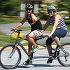 PETE BANNAN-DIGITAL FIRST MEDIA  Volunteer Beth Foster and  camper Lexi Deel,15, of New Castle ,enjoy the tandem bike ride at Camp Abilities at West Chester University. The camp, held over the Memorial Day weekend offers developmental sports for school-age children who have visual impairments including blindness or low vision.