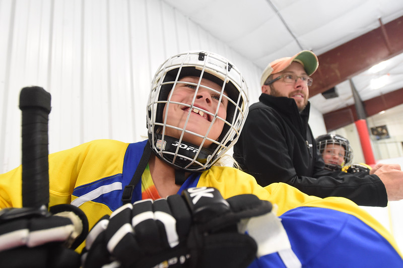 PETE  BANNAN-DIGITAL FIRST MEDIA    <br /> Cooper Jones,9, watches action between shifts with her father, coach Mike Jones and twin brother Ryder. They live in Downingtown.