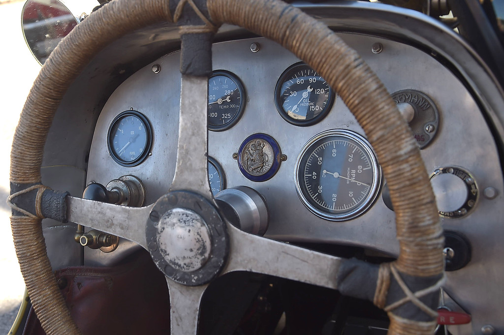. PETE  BANNAN-DIGITAL FIRST MEDIA    The console of David George\'s 1936 twin cam four cylinder opened wheeled Indy champ car includes a St. Christopher medal. St. Christopher is the patron Saint of travelers.