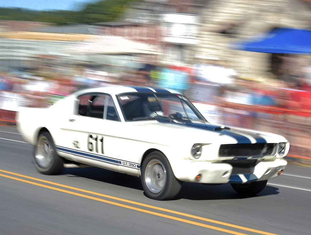 . PETE  BANNAN-DIGITAL FIRST MEDIA   A Mustang GT roars down Lincoln Highway during the second Annual Coatesville Invitational Vintage Grand Prix Saturday Sept.23, 2017. Over 50 cars took part in  the day long timed races.
