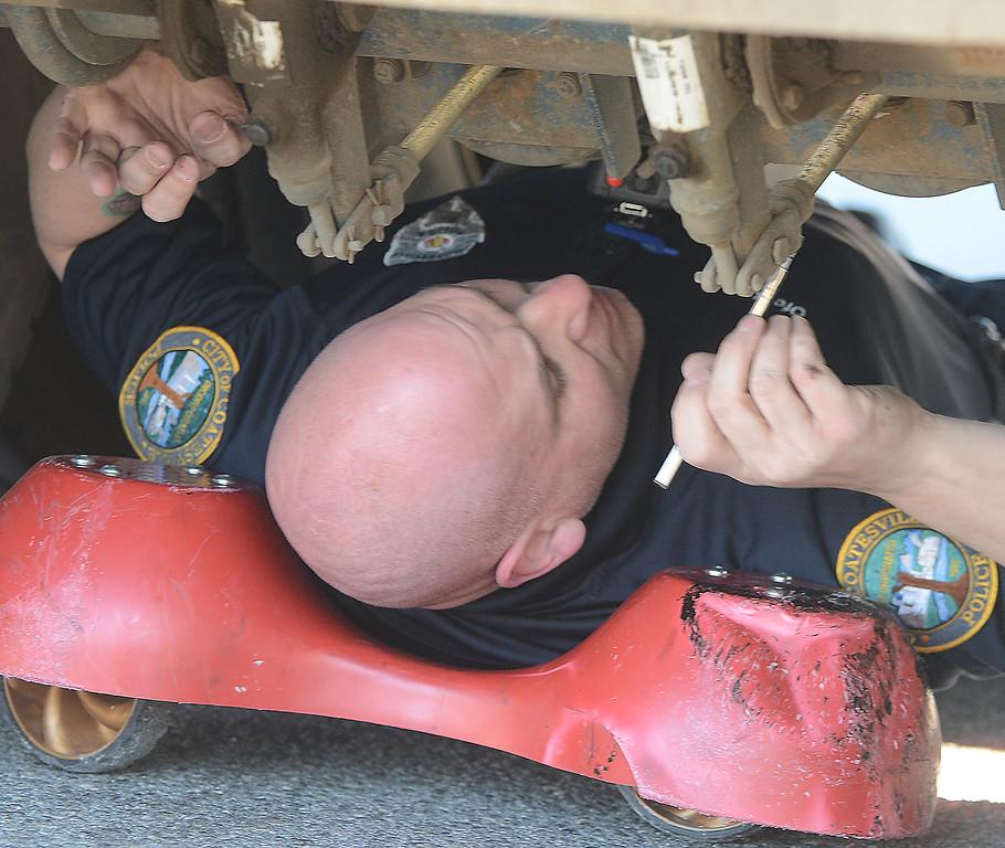 . Coatesville police officerOfficer Guy Bruchstein checks the  rear breaks of a trailer . PETE BANNAN-DIGITAL FIRST MEDIA