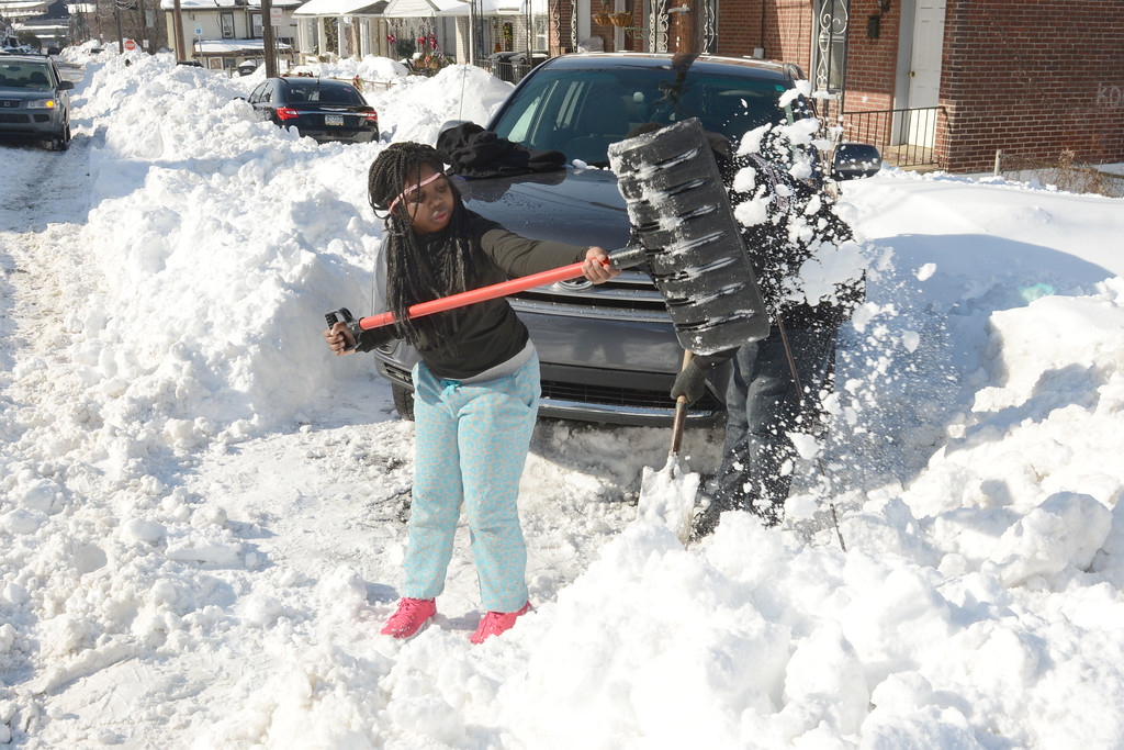 . Makkysha Stevens, 9, and her uncle, George Jones, obscured shovel out their car in Coatesville Monday Jan. 25, 2016, two days after a historic storm left over 20 inches of snow in Chester County. PETE BANNAN DIGITAL FIRST MEDIA