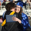 PETE BANNAN-DAILY LOCAL NEWS  Mary Mahan gets  her diploma and a hug from her mom, Downingtown West teacher Michelle Mahan at Downingtown West commencement Thursday June 9, 2016 at Koffmeyer Stadium.