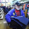 PETE  BANNAN-DIGITAL FIRST MEDIA   Buddy Rhodes of Coatesville carries clothing from the Coatesville Army & Navy store as part of leftover inventory that the store sold them at a reduced price so they can distribute in to the Coatesville VA and to youth groups.