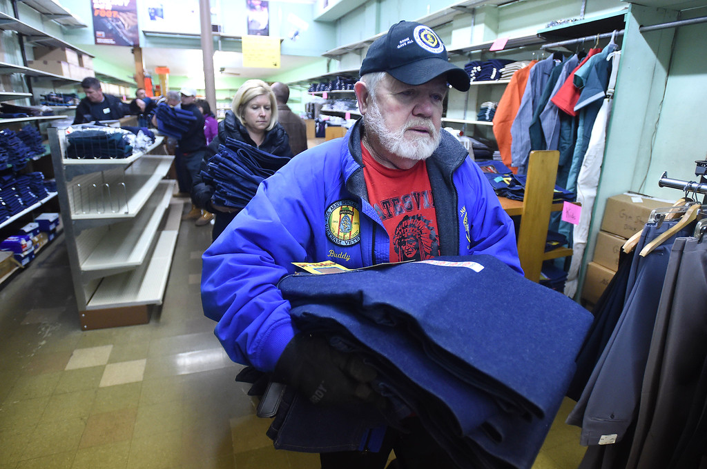 . PETE  BANNAN-DIGITAL FIRST MEDIA   Buddy Rhodes of Coatesville carries clothing from the Coatesville Army & Navy store as part of leftover inventory that the store sold them at a reduced price so they can distribute in to the Coatesville VA and to youth groups.