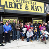 PETE  BANNAN-DIGITAL FIRST MEDIA   Volunteers and staff out front of the Coatesville Army & Navy store after helping clear clothing from the closed store as part of leftover inventory that the store sold them at a reduced price so they can distribute in to the Coatesville VA and to youth groups.