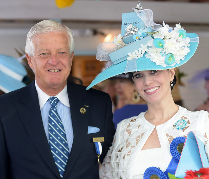 PETE BANNAN - DIGITAL FIRST MEDIA        Wayne Grafton, chairman of the Devon Horse Show and  Tiffany Arey of Collegeville with her Devon & Company Tiffany styled hat.