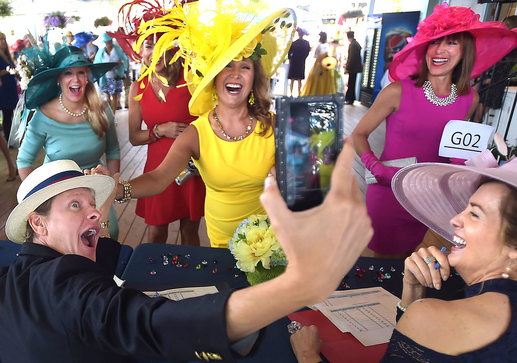 . PETE BANNAN - DIGITAL FIRST MEDIA      Television personality Carson Kressley, left, take a selfie with Devon ladies  group hat winners Sharon Bozentka, Joanne Bogan(obscured) Anette Brennan ,Tina Aberant and judge Caroline O\'Halloran(bottom right). Over 125 area women sporting their finest bonnets, chapeaus and headpieces took part in the annual hat contest at Ladies Day at Devon Horse Show and Country Fair Wednesday.