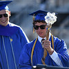 PETE BANNAN-DAILY LOCAL NEWS   Downingtown East Class of 2016 valedictorian, Evan Patrick Diewald carries the 'spirit staff' during commencement at Kottmeyer Stadium in Downingtown Wednesday evening.