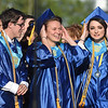 "PETE BANNAN-DAILY LOCAL NEWS   Downingtown East Class of 2016 choir members hold onto their hats as they sing ""Let theRIver Run"" during commencement at Kottmeyer Stadium in Downingtown Wednesday evening."
