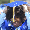PETE BANNAN-DAILY LOCAL NEWS   Downingtown East Class of 2016  Sebasatian O. Adebanjo tries to adjust his cap during commencement at Kottmeyer Stadium in Downingtown Wednesday evening.