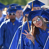 PETE BANNAN-DAILY LOCAL NEWS   Downingtown East Class of 2016 senior Presleigh E. Stengel flashes the peace sign as she walks into commencement at Kottmeyer Stadium in Downingtown Wednesday evening.