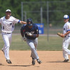 PETE BANNAN-DIGITAL FIRST MEDIA    Downingtown shortstop Ken Jarema tags out Spring City's #15 Jeremiah Ndjali after he got caught in a rundown trying to steal second base in game one in American Legion baseball.