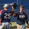 PETE BANNAN-DIGITAL FIRST MEDIA  Spring City's gets a helmet bump from teammate Brad Clemens after scoring in game two against Downingtown.
