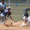 PETE BANNAN-DIGITAL FIRST MEDIA    Downingtown Michael Mollenhauer  slides safely into home as Spring City  pitcherCamorn Michaud covers in American Legion baseball.