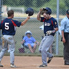 PETE BANNAN-DIGITAL FIRST MEDIA  Spring City's Brian Varani is greeted at home by Owen Gulati after homered against Downingtown in game one Tuesday.