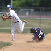 PETE BANNAN-DIGITAL FIRST MEDIA    Spring City runner Brad Clemens breaks up the double play as Downingtown Douglas Conrad holds the throw in game one of American Legion baseball Tuesday.