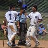 #iPETE BANNAN-DIGITAL FIRST MEDIA    Downingtown's #40 Josh Marcelli is greeted at home by Justin Mortiz after slamming a two run home rune in game 1 against Spring City in American Legion baseball.