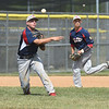 PETE BANNAN-DIGITAL FIRST MEDIA    Spring City third baseman Brad Clemens throws to first in the first game against Downingtown  in American Legion baseball Tuesday.