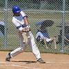 PETE BANNAN-DIGITAL FIRST MEDIA    Downingtown's #40 Josh Marcelli slams a two run homer against Spring City in  game one.