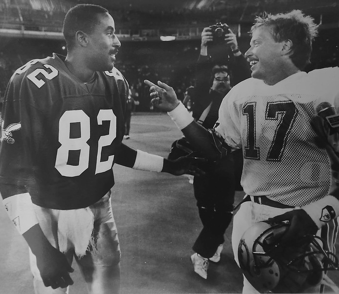 DAILY LOCAL ARCHIVES - Mike  Quick meets with former Eagles quarterback Ron Jaworski after the game. December 19'87. Quick had 4 receptions and a touchdown in the 28-10 lose. Jaworski didn't play.