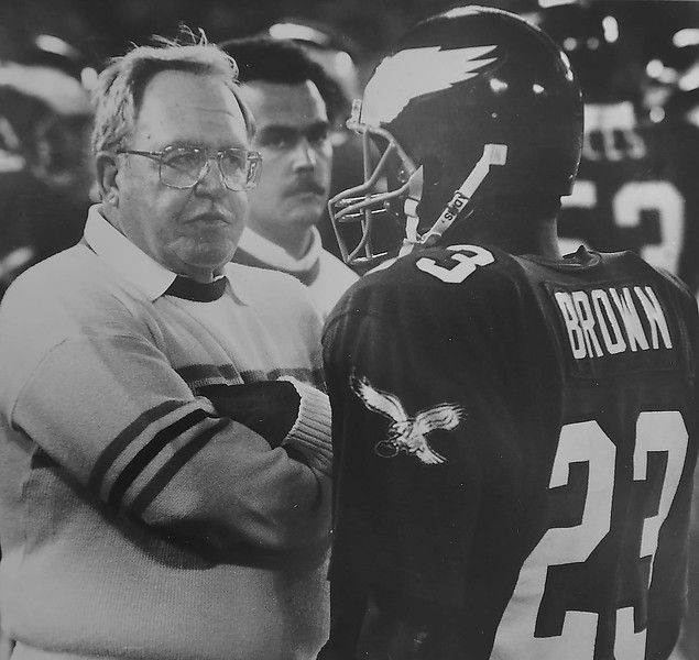 Ryan talks to Cederic Brown after interception. 1987 DAILY LOCAL NEWS ARCHIVES