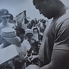 Reggie White signs football autographs. Photo by Kristen Cortazzo DAILY LOCAL NEWS ARCHIVES