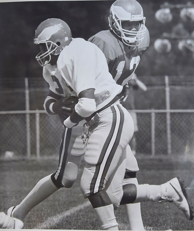 . DAILY LOCAL ARCHIVES -  Cunningham hands off to Toney during scrimmage. Photo by John Stoneback
