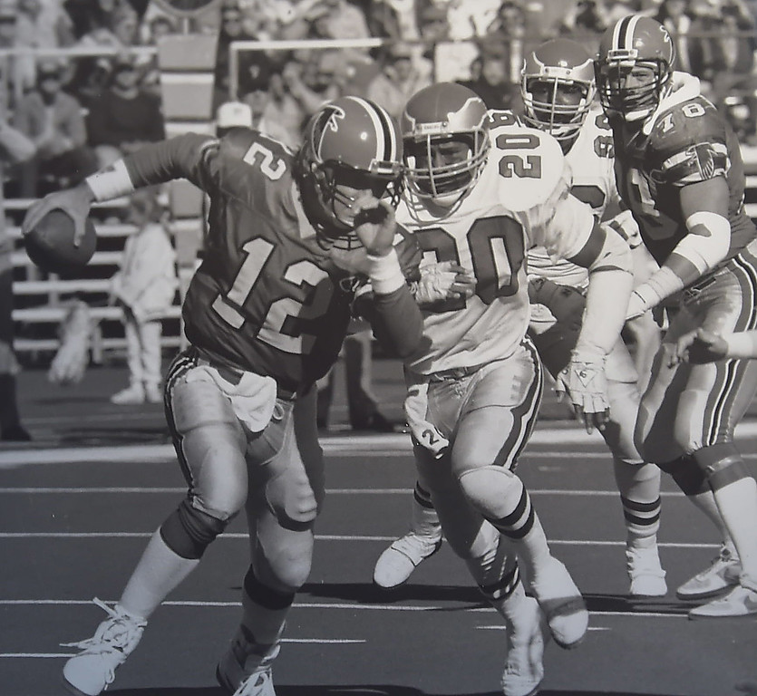 . Andre Waters chases Atlanta\'s Chris Miller. Photo by Bill Stonebeck DAILY LOCAL NEWS ARCHIVES