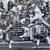 Randall Cunningham goes airborne against the Atlanta Falcons.  Photo by Bill Stoneback  DAILY LOCAL NEWS ARCHIVES.