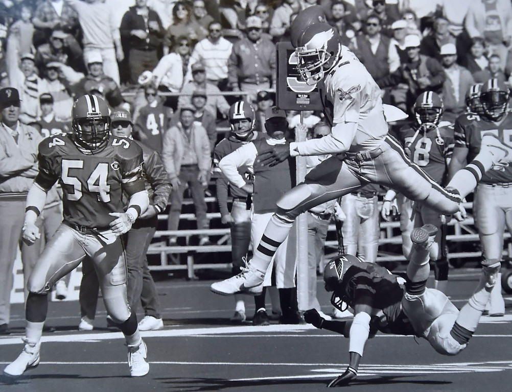 . Randall Cunningham goes airborne against the Atlanta Falcons.  Photo by Bill Stoneback  DAILY LOCAL NEWS ARCHIVES.