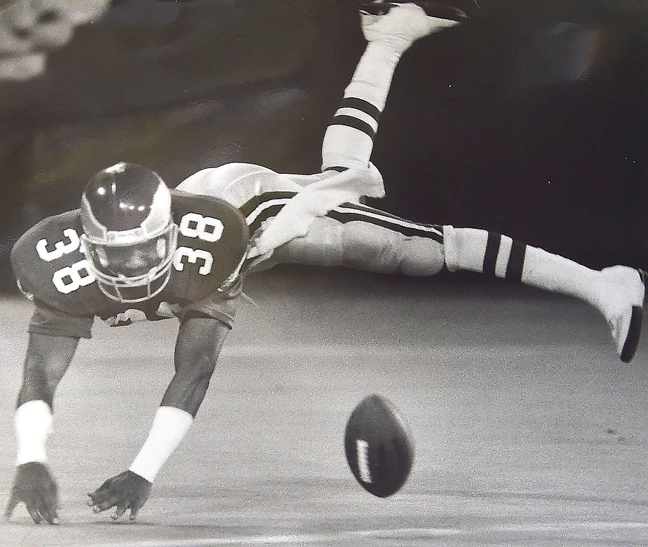 . DAILY LOCAL NEWS ARCHIVES  - #38 Russel Gary downs the ball inside the 5 after the Eagles punted.  photo- DAILY LOCAL NEWS ARCHIVES.