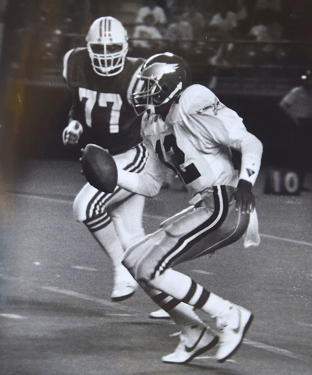. #12 Randell Cunningham and #77 Kenneth Sims, defensive end Photo by. Kristen Cortazzo  DAILY LOCAL NEWS ARCHIVES