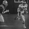 #25 Anthony Toney  runningback is  chased by Tim Jordan of the New England Patriots. Kristen Cortazzo  DAILY LOCAL NEWS ARCHIVES