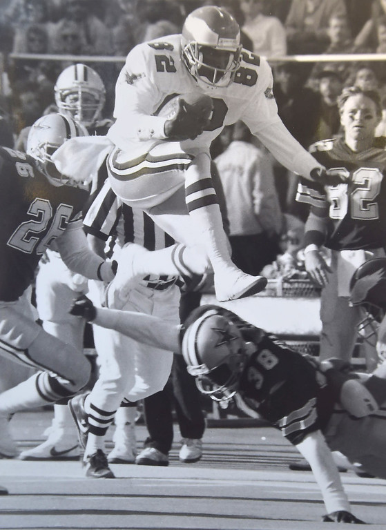 . Mike Quick hurdles defenders on way to big gain. DAILY LOCAL NEWS ARCHIVES