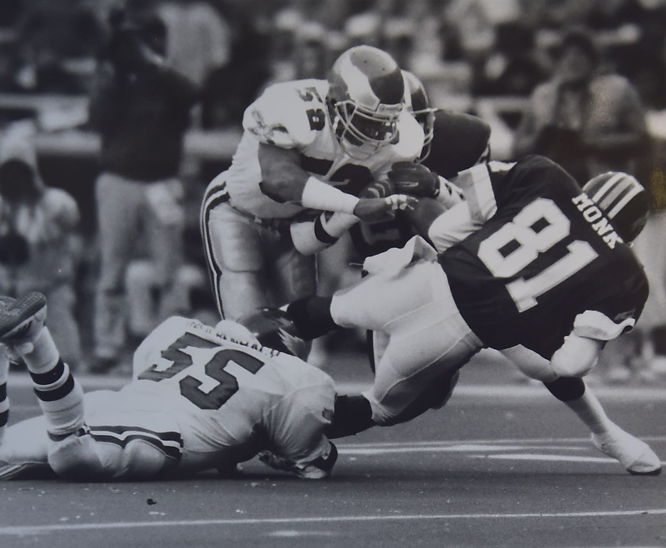 . Eagles\' (58) TY Allert and (55) Mike Reichenbach tackle Redskins Art Monk. Photo Ben Morrison.  DAILY LOCAL NEWS ARCHIVES