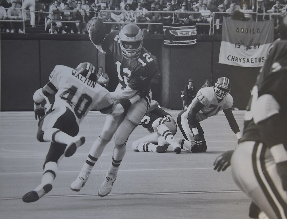 . Randell Cunningham tries to pass decides to run. Sets up for first touchdown against the Redskins. The Eagles went on to win 31-27 at Veterans Stadium.. DAILY LOCAL NEWS ARCHIVES