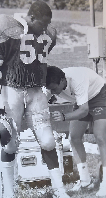 . Dwyane Jiles gets his leg taped. Photo by Larry McDevitt DAILY LOCAL NEWS ARCHIVES