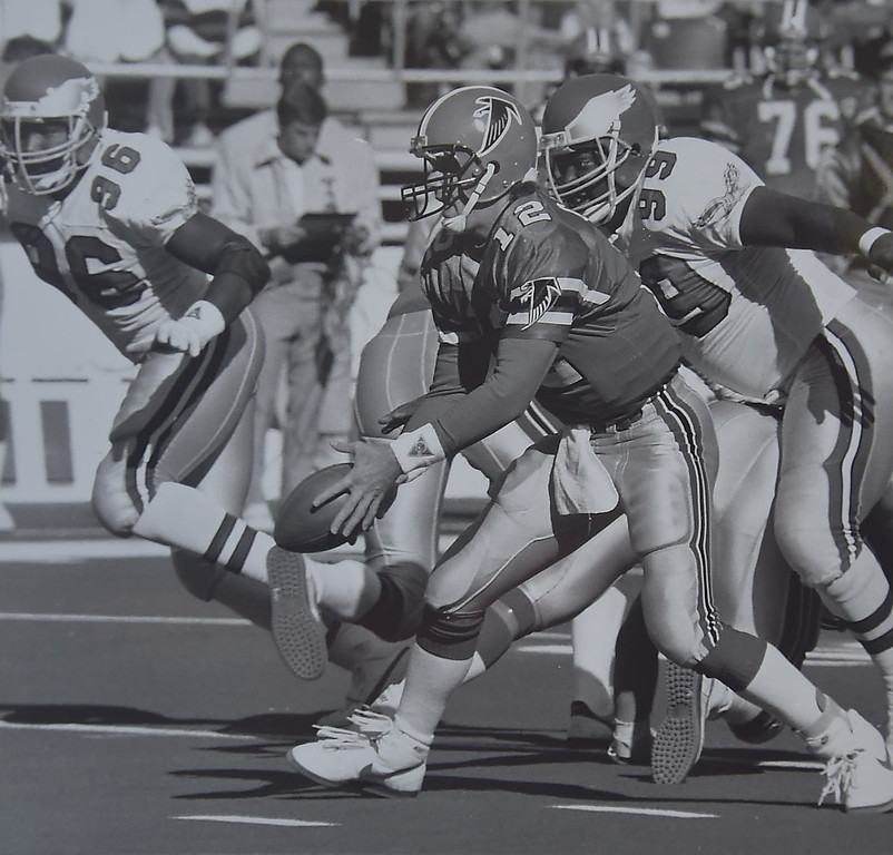 . Atlanta quarterback Chris Miller chased by (99) Jerome Brown. Photo by Bill Stoneback  DAILY LOCAL NEWS ARCHIVES.