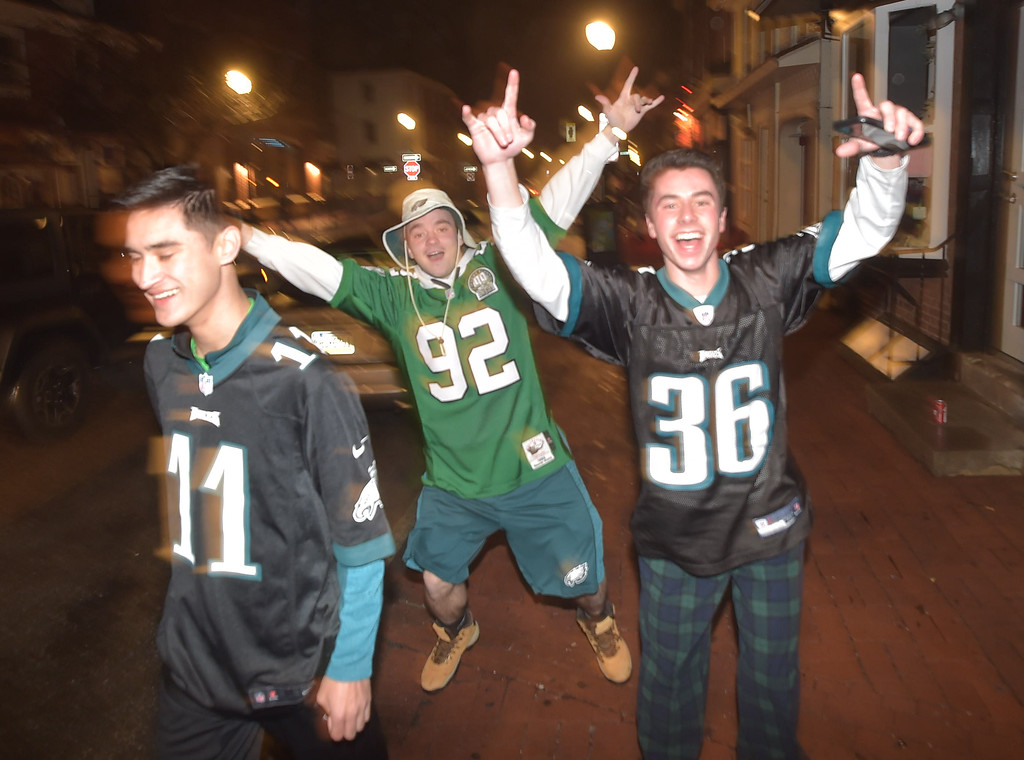 . PETE BANNAN-DIGITAL FIRST MEDIA     Fans celebrate in West Chester after the Eagles won their first Super Bowl Championship Sunday Feb. 4, 2017, defeating the defending champion New England Patriots.