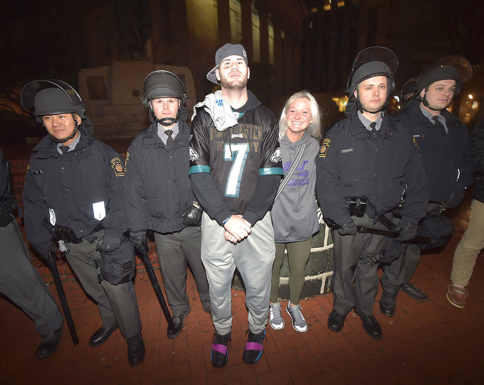 . PETE BANNAN-DIGITAL FIRST MEDIA     Fans pose with Pennsylvania State Troopers after the Eagles won their first Super Bowl Championship Sunday Feb. 4, 2017, defeating the defending champion New England Patriots.