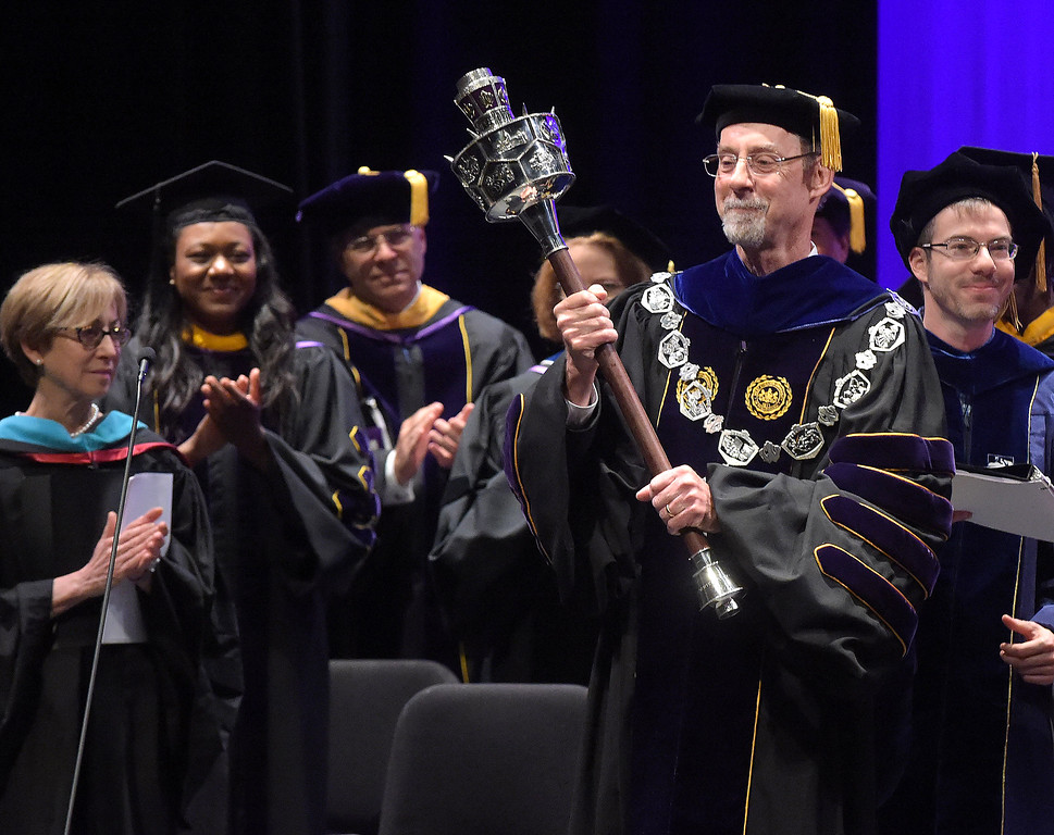 . PETE  BANNAN-DIGITAL FIRST MEDIA         West Chester University President Christopher Fiorentino  holds the Mace after he was formally inaugurated as the president Friday in a ceremony at Emilie K. Asplundh Concert Hall.   The mace has a history as a symbol of authority in civil and academic processions. Now ceremonial, the mace was originally a formidable weapon held ready to protect the dignitary in a procession.
